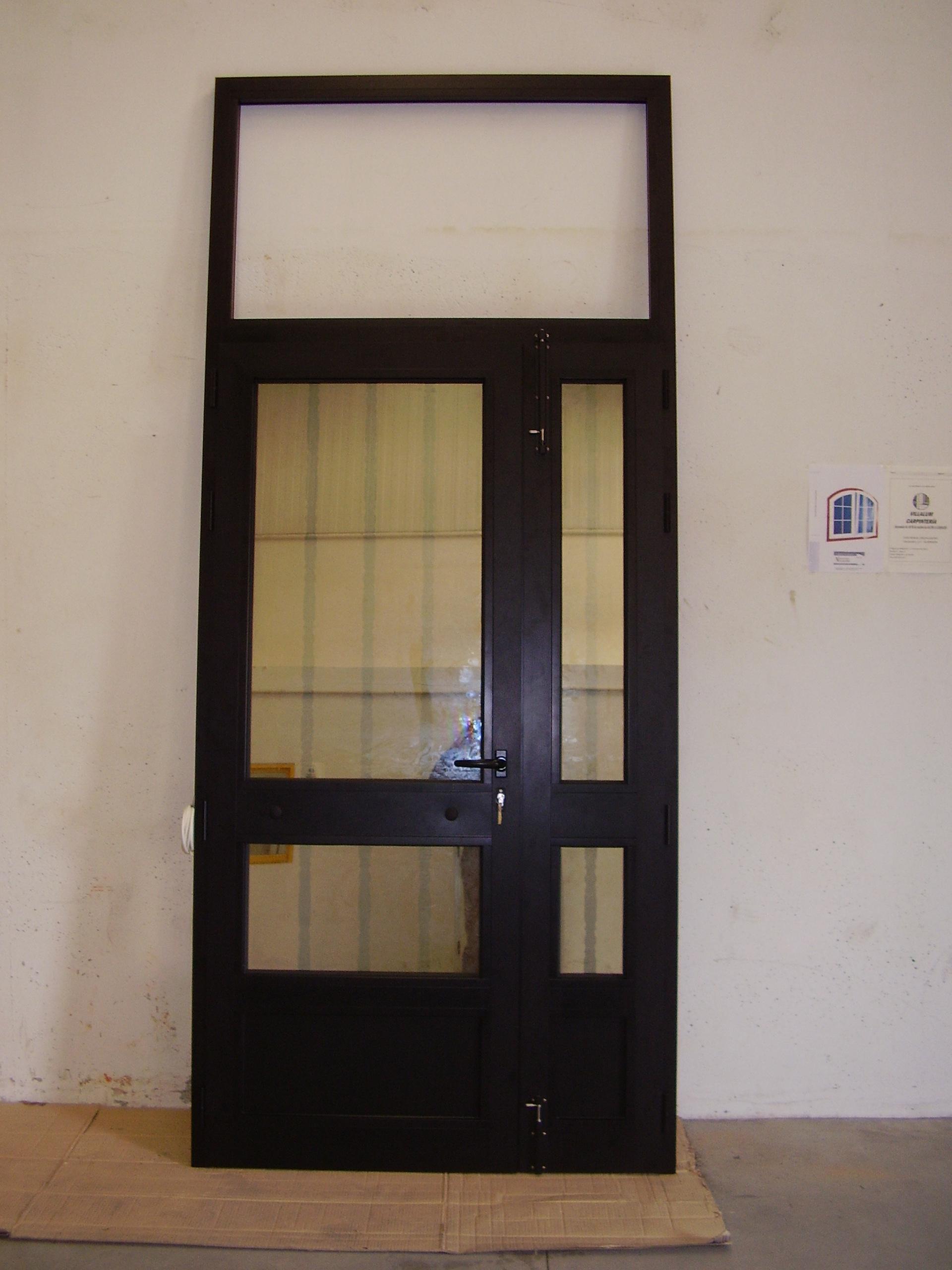 Puerta edificio 2 hojas y fijo superior